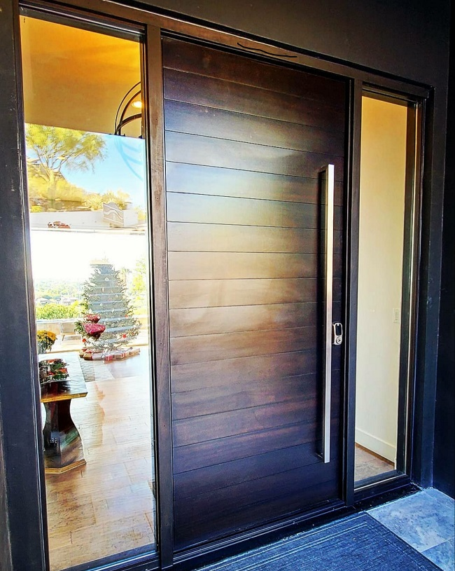 High end wooden residential door with glass sides
